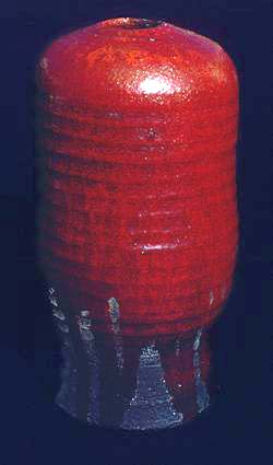 Raku urn with red lead glaze
