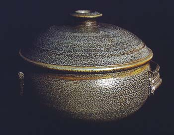 Shallow domed, salt fire covered casserole.