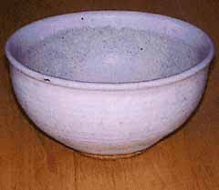 Wheel thrown stoneware kitchen bowl with a subtle blush glaze.