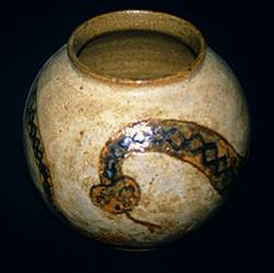 Wheel thrown stoneware pot with southwestern motif and Mojave rattlesnake design.