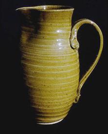 Tall stoneware pitcher with clear glaze.