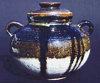 Stoneware jar with Tenmoku glaze and ring lugs that provide lift.